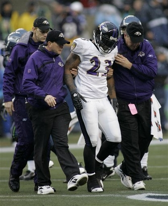 Baltimore Ravens running back Willis McGahee (23), center, is taken off the field with bruised ribs in the first half against the Seattle Seahawks on Sunday afternoon.