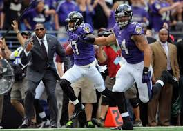 Ray Lewis cheering on Tandon Doss, as he heads for the endzone.
